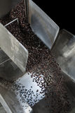 Coffee beans. Automated coffee beans factory, Coffee roasting machine Royalty Free Stock Photos