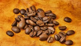 Coffee beans on autumn leaves Stock Photo