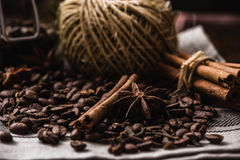 Coffee beans with autumn spices on the tablecloth. Warming and fragrant set Royalty Free Stock Image