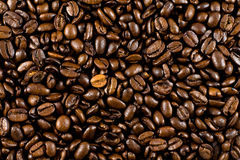 Coffee beans background. A background of freshly roasted coffee beans Stock Photo