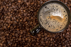 Coffee beans background and black cup Stock Photo