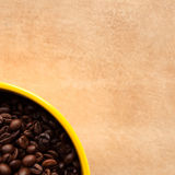 Coffee beans background. Coffee beans bowl on table. Free copy space for text Royalty Free Stock Photography