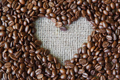 Coffee beans background with burlap heart frame Stock Photos