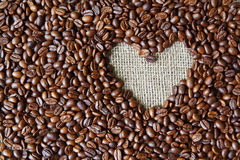 Coffee beans background with burlap heart frame Stock Photo