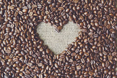 Coffee beans background with burlap heart frame Royalty Free Stock Photography