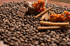 Coffee beans background with cinnamon, and chocolate. Wallpaper stock images