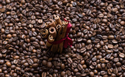 Coffee beans background with cinnamon. Wallpaper royalty free stock photography
