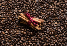 Coffee beans background with cinnamon. Wallpaper stock photo