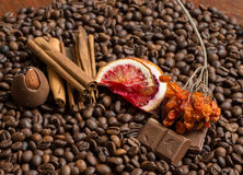 Coffee beans background with citrus cinnamon, and chocolate. Wallpaper stock photos