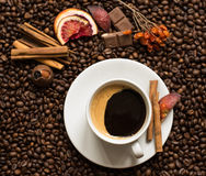Coffee beans background with cofee cup, cinnamon, and chocolate. Wallpaper stock image