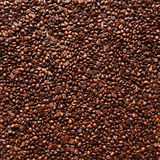 Coffee beans background. Freshly roasted coffee beans are on the table evenly. Top view Stock Photos