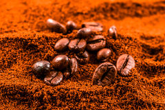 Coffee beans. Background with coffee beans and ground coffee Royalty Free Stock Photography