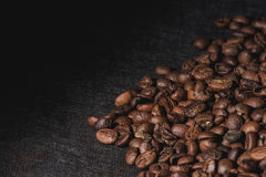 Coffee beans are the background. Royalty Free Stock Photography