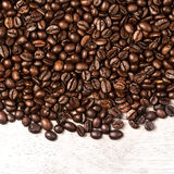 Coffee beans background macro. Dark Roasted coffee beans textured wallpaper. For your design with copy space Stock Image