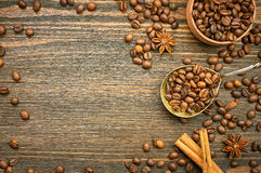 Coffee beans background with spoon. Roasted coffee in the spoon. Top view. Selective focus. Place for text Royalty Free Stock Photo