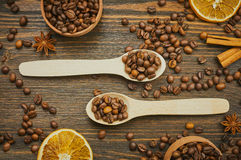 Coffee beans background with spoons. Roasted coffee in the spoon. Top view. Selective focus Stock Photo