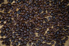 Coffee beans background on wooden, Fresh coffee beans with coffee cup on wooden background, Drinking set background Stock Photos