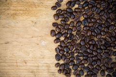 Coffee beans background on wooden, Fresh coffee beans with coffee cup on wooden background, Drinking set background Royalty Free Stock Images