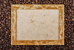 Coffee beans background with wooden picture frame. Top view with copy space Royalty Free Stock Photo