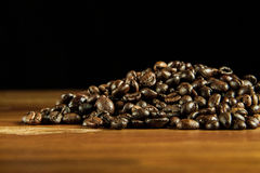 Coffee beans background. Coffee beans on a wooden table Royalty Free Stock Photography