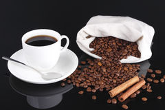 Coffee and beans from bag. Coffee cup and coffee beans from bag Royalty Free Stock Photos