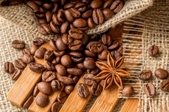 Coffee beans in a bag. Coffee beans in a burlap bag on a wooden background Stock Photo