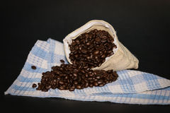 Coffee beans in bag.dark background Stock Images