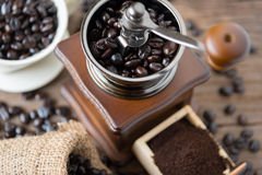 Coffee beans in the bag and grinder Stock Image