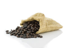 Coffee beans in bag isolated on white background Royalty Free Stock Image