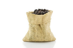 Coffee beans in bag isolated on white background Royalty Free Stock Images