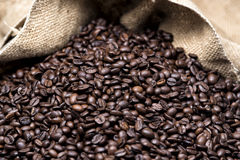 Coffee beans in bag. Coffee beans are poured from a linen bag Royalty Free Stock Images