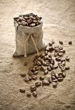 Coffee beans in bag on sacking Stock Photography