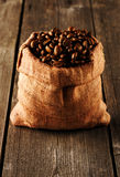 Coffee beans in bag on table Royalty Free Stock Image