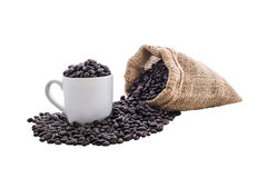 Coffee beans in bag and white coffee cup Royalty Free Stock Image