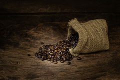 Coffee Beans in a Bag on wood Royalty Free Stock Photo