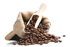Coffee beans in bag with wooden spoon. Royalty Free Stock Photos