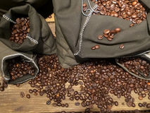Coffee beans on bags Stock Image