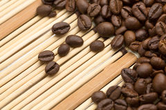 Coffee beans on a bamboo napkin Royalty Free Stock Photo