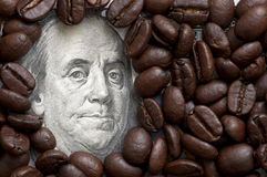 Coffee beans on bank note Royalty Free Stock Photography