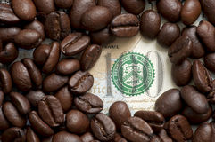 Coffee beans on bank note Royalty Free Stock Photo