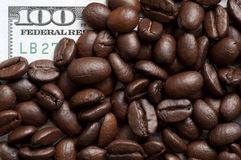 Coffee beans on bank note Royalty Free Stock Images