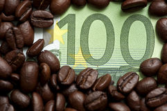 Coffee beans on bank note Stock Image