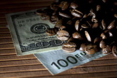 Coffee beans on bank notes (bills) Stock Photography