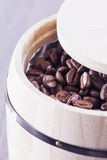 Coffee beans in barrell Stock Photo