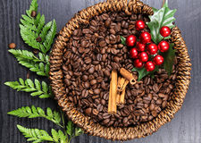 Coffee beans. A basket of Coffee beans with Christmas decoration on wooden background Royalty Free Stock Image