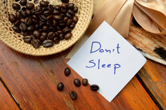Coffee beans in basket and don't sleep note. On the wooden background Stock Photography