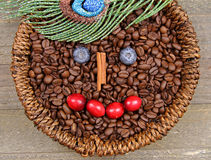 Coffee beans. A basket of Coffee beans with happy face on wooden background Stock Photography