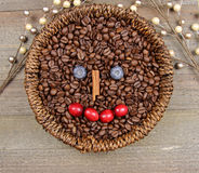 Coffee beans. A basket of Coffee beans with happy face on wooden background Stock Images