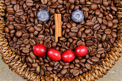 Coffee beans. A basket of Coffee beans with happy face on wooden background Stock Image