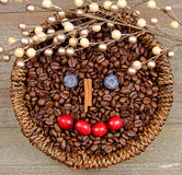 Coffee beans. A basket of Coffee beans with Happy face on wooden background Royalty Free Stock Photos